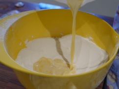 Pour the mixture into the flour well.